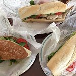 Three sandwiches for take out beach lunch