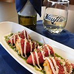 Homemade filling, sauces and toppings: Lump Crab Stuffed Piquillo Peppers on Chive Oil with Chip