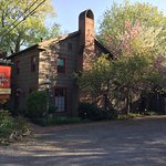 A sunny spring day with white bud and cherry trees in bloom at the 1795 Acorn Inn Bed and Breakf