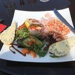 Seafood platter, crayfish, prawns, hot smoked salmon, salad, bread and seafood sauce.