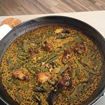 Valencian Paella with rabbit, snails, artichokes and beans.