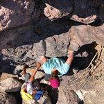 Scrambling down the rocks