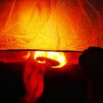 Firey Sky lanterns sent high up into the sky set the dark night sky ablaze