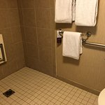 Room 412 with roll in shower for handicapped guests. Bed is close to bathroom.