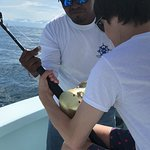 My teen learning how to fish. Caught a 70+ wahoo