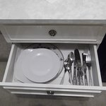 drawer with plates and cutlery? why???