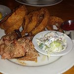 Carolina pork platter with onion rings and cole slaw