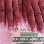 Acrylic french tips done at Soft Touch Day Spa. Also showing ur loyalty card.