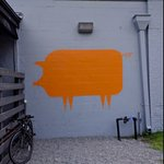 This pig is painted on the wall on as you go into the patio area