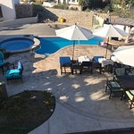 The Residences - view of pool, fire pit and patio from main floor terrace balcony
