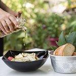 The famous Greek Salad (in greek: Choriatiki): fresh local tomato, cucumber, olive, feta cheese
