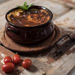 Greek moussaka: served within a hot pottery straight out of the wooden oven