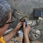 Lolo working on his last piece of bronze