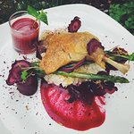 Duck confit with texture of beets and calendula risotto