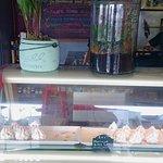 Inside the cafe, dessert fridge and menu items