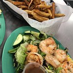 House Salad topped with grilled shrimp & Hand Pattied burger with hand cut fries