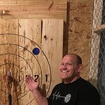 Proud father of a bullseye he carefully raised