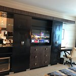 Mini bar and entertainment station with work desk / power station