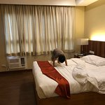 V Hotel and Apartel Image