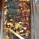 "Okonomiyaki, sometimes call ""Japanese pizza"""