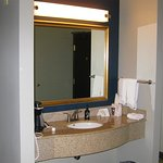 The sink is in the guest room instead of inside a proper bathroom.