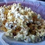 a basket of popcorn with seasoning