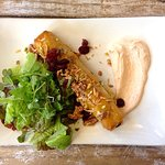 Moroccan pie - spiced butternut, nuts and cranberries in filo pastry with a harissa yoghurt sauc