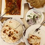 Naan bread with a mutton dish.