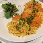 Scampi Maison Scampi cooked in a lemon, brandy, cream and tomato sauce served with rice.