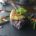 Cast iron sea bass with purple sweet potato puree