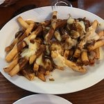 Poutine with cheese and plain brown gravy.