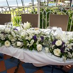 Reception dinner flowers in a private room upstairs by the beach