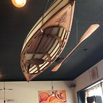Canoe and paddle suspended from ceiling, Realm Food Co, Craig street, Parksville, BC