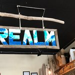 Realm sign above order station, Realm Food Co, Craig street, Parksville, BC