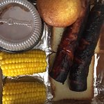 double sausage, corn on cob, Wilbur beans, and corn muffin.