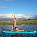 Stand Up Paddle Board Yoga in the summer months on the Kawatiri River (Buller River)