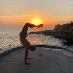 Yoga seaside at sunset, at the Westender Inn