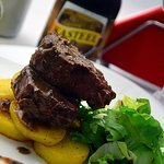 Beef sirloin with brown sauce and truffles