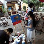 Kid creating a wonderful picture by acrylic paints at Van Lake