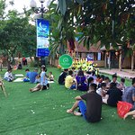Kids learning how to make kites with parents in an eco-friendly space