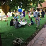 Kids learning how to make a kite in an eco-friendly space
