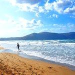 Our son Paul runs on the blue flag beach at Mythos Palace