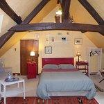 la grande chambre Haute avec petit canapé détente