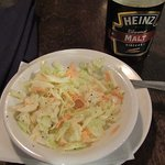 The coleslaw tasted better with a sprinkle of malt vinegar on it.