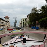 Cruising through Old Havana in our vintage convertible!