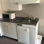 Fridge, stovetop, microwave; drawers and cupboards for kitchenette utensils