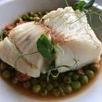 baked hake with green peas - perfectly cooked