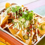Barrio fiesta sized loaded Nachos - you can have them meaty, veggie or vegan!