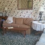 Our den and television room, perviously the formal dining room, where guests mingle and make fri