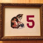 Room numbers were all sweet cat cross-stitches such as this one for our room. :-)